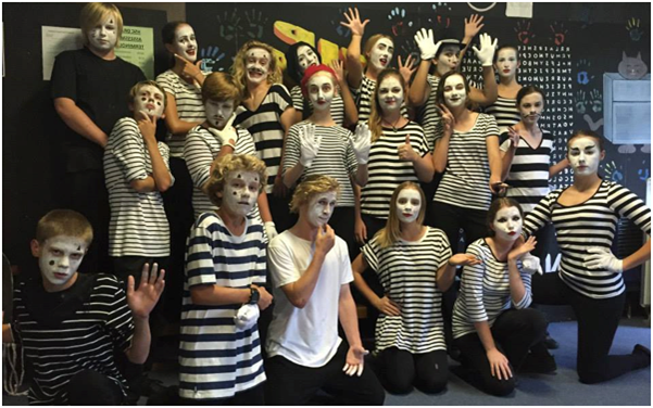 Students dressed as mime artists posing in a group