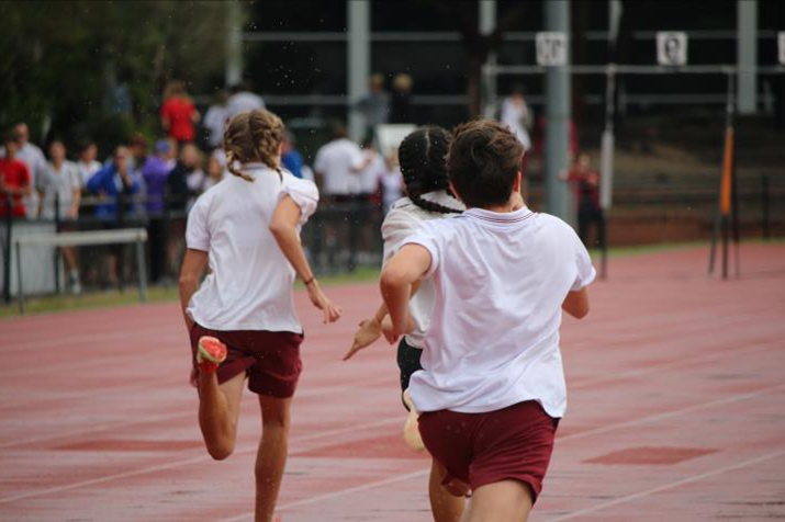 Students running in the running lanes on sports day